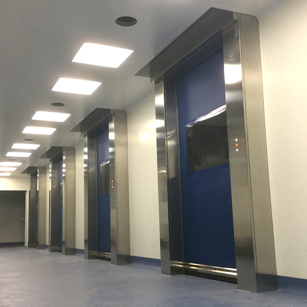 Blue roll up doors for cleanrooms